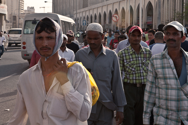 Migrant workers congregate near Bank Street in central Doha on Friday, the weekly day of rest. Some 1.19 million of the 1.26 million people employed in Qatar come from abroad.