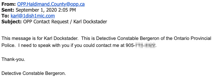 "Screenshot of a September 1 email from OPP.Haldimand.County@opp.ca to karl@1dish1mic.com with the subject line ""OPP Contact Request / Karl Dockstader."" The body just says: ""This message is for Karl Dockstader. This is Detective Constable Bergeron of the Ontario Provincial Police. I need to speak with you if you could contact me at 905-[redacted]. Thank-you. Detective Constable Bergeron."""